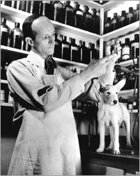Dr. Mark Morris Sr. with dog in the lab